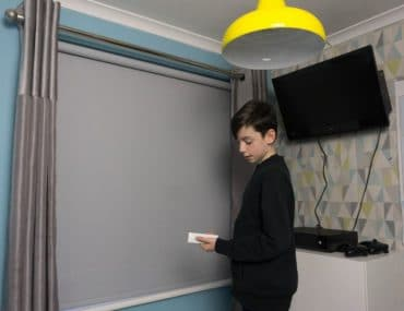 Electric blind. Is an electric blind worth it? Electric blinds are cord free blind so no risk. Electric blinds are safe and easy to use. Boys bedroom with grey blind. Blue and grey bedroom