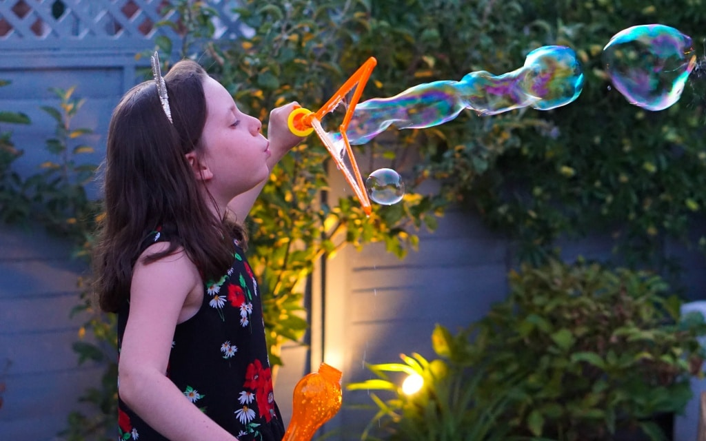 Philips hue smart outdoor lily spot lights with girl blowing bubble